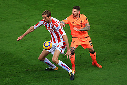 29th November 2017 - Premier League - Stoke City v Liverpool - Peter Crouch of Stoke battles with Alberto Moreno of Liverpool - Photo: Simon Stacpoole / Offside.