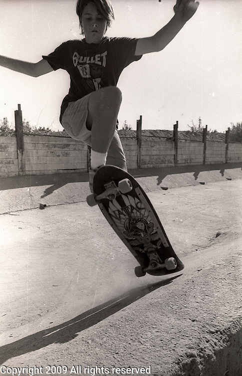 Skateboarding session in an irrigation control ditch near the Tule River in Porterville, California.