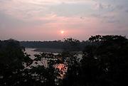 Sunset,over Madre de Dios River, edge of Jungle Forest, Primary Rainforest, Manu, Peru, Amazonian, orange colours, canopy, silhouette.