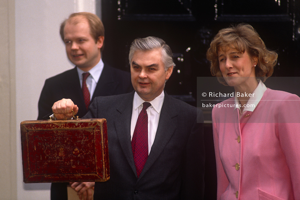 Chancellor of the Exchequer and Conservative MP, Norman Lamont with wife Rosemary (with William Hague in the background) on the steps outside 11 Downing Street on budget day on 19th March 1991 in London, England.