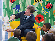"""© Licensed to London News Pictures. 13/10/2014. London, UK. Nick Clegg reads from """"Mr Wolfs Pancakes"""" The Deputy Prime Minister, Nick Clegg, visits Greenside Primary School in Shepherd's Bush on Monday 13th October 2014 to launch a new campaign called Primary Futures – a new strand of the Inspiring the Future campaign. Photo credit : Stephen Simpson/LNP"""