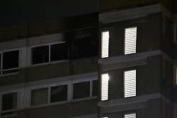 © Licensed to London News Pictures. 12/10/2021. London, UK. Fire fighters are at the scene of a block of flats on Westbridge Road in Battersea, South-West London. It is reported the fire started early evening and over ten fire engines are at the scene. Photo credit: Ray Tang/LNP