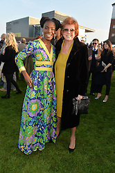 Left to right, SHINGAI SHONIWA and CILLA BLACK at the 2014 Hennessy Gold Cup at Newbury Racecourse, Newbury, Berkshire on 29th November 2014.  The Gold Cup was won by Many Clouds ridden by Leighton Aspell.