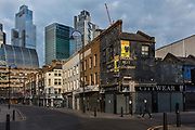 A closed Petticoat Lane market overlooked by City of London skyline during the coronavirus pandemic on the 4th May 2020 in London, United Kingdom.