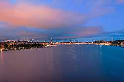 City lit up at dusk, Riddarfjarden, Stockholm, Sweden