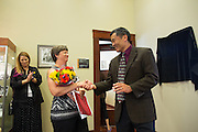 MUSD Superintendent Cary Matsuoka, right, shares a story of Austa Falconer, left, during the Rotary Club Leo B. Murphy Award ceremony for MUSD Teacher of the Year at the Milpitas Public Library in Milpitas, California, on August 31, 2015. (Stan Olszewski/SOSKIphoto)