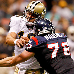 August 21, 2010; New Orleans, LA, USA; Houston Texans defensive end Jesse Nading (72) hits  New Orleans Saints quarterback Chase Daniel (10) after he throws during the second half of a 38-20 win by the New Orleans Saints over the Houston Texans during a preseason game at the Louisiana Superdome. Mandatory Credit: Derick E. Hingle