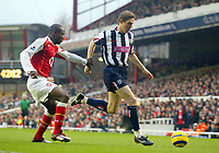 20/11/2004 - FA Barclays Premiership - Arsenal v  - West Bromich Albion - HIghbury Stadium, London<br />Arsenal's Lauren chases West Bromich Albion's Zoltan Gera<br />Photo:Jed Leicester/Back Page Images