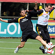Galatasaray's players Baris OZBEK (L) and Lucas NEILL (R) during their training session at the Jupp Derwall training center, Tuesday, April 20, 2010. Photo by TURKPIX