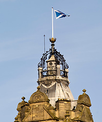 Pictured: The saltire above the Balmoral on Edinburgh's Princes Street flies over a city considering the impact of a second independence referendum<br /> <br /> Ger Harley   EEm 15 March 2017