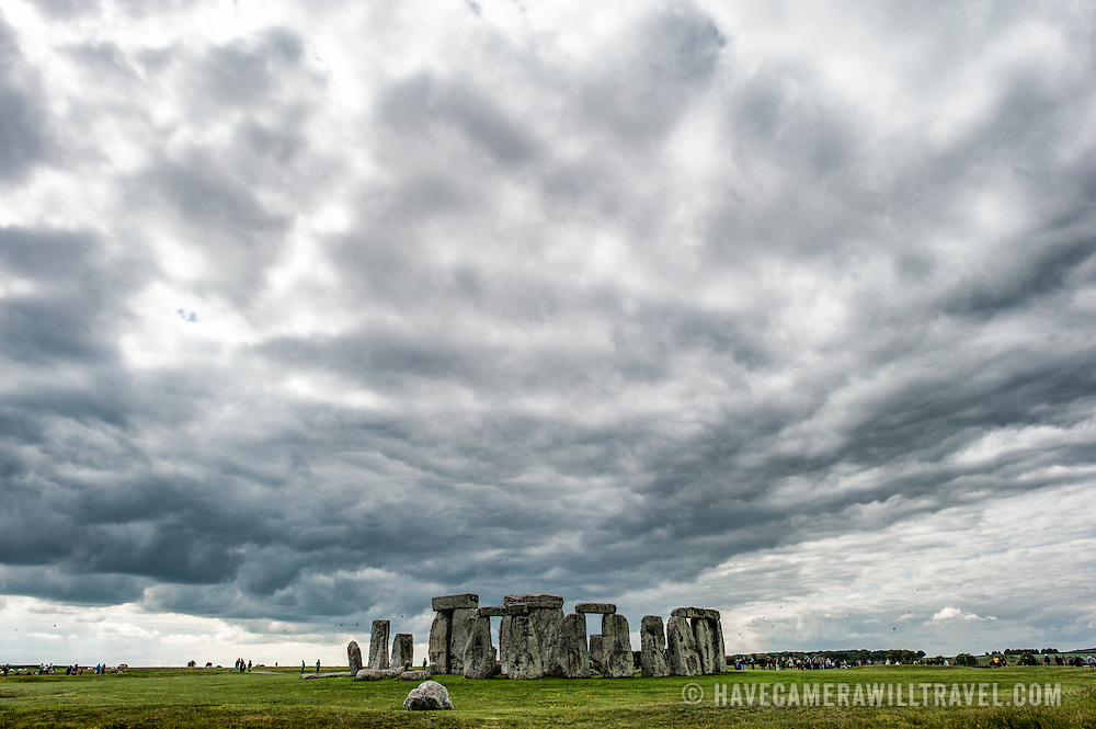 Stonehenge with Threatening Skies. Believed to have been built somewhere between 2000 and 3000 BC, Stonehenge is one of the United Kingdom's most distinctive landmarks. It's function and purpose remains a matter of conjecture, although many theories have been offered. It consists of a series of large standing stones, some of which have toppled over the centuries. Stonehenge is located in Salisbury Plain west of London.