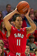 DALLAS, TX - JANUARY 4: Nic Moore #11 of the SMU Mustangs brings the ball up court against the Connecticut Huskies on January 4, 2014 at Moody Coliseum in Dallas, Texas.  (Photo by Cooper Neill) *** Local Caption *** Nic Moore