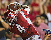 Arkansas wide receiver Jarius Wright (4) makes a catch in the end zone during an NCAA college football game against Auburn on Saturday, Oct. 8, 2011, in Fayetteville, Ark. (AP Photo/Beth Hall)