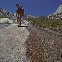 A hiker descends a granite slab in the Sierra Nevada above Lone Pine, California.