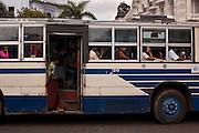 A full bus in the streets of the biggest city of Myanmar, Yangon. Burma.<br /> Note: These images are not distributed or sold in Portugal
