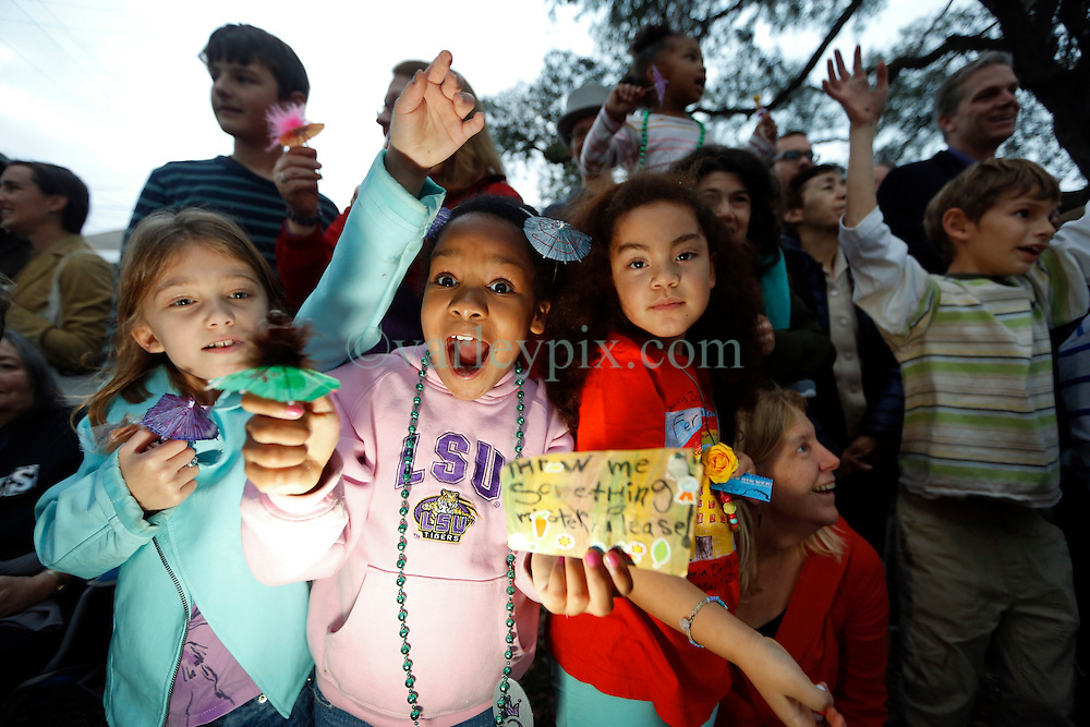 30 January 2016. New Orleans, Louisiana.<br /> The excitement of catching throws at the mico-Krewe of 'Tit Rex' parade in the Bywater and Marigny. All the floats are scaled down versions of the current parade giant with a shoe box at their base. The theme for this year's parade was 'No Big Deal.' <br /> Photo©; Charlie Varley/varleypix.com