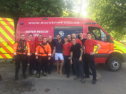 """Russell Brand releases a photo on Twitter with the following caption: """"""""Pay these heroes what their worth. Especially the sexy one in shorts - look at that pose! @Bucksfire"""""""". Photo Credit: Twitter *** No USA Distribution *** For Editorial Use Only *** Not to be Published in Books or Photo Books ***  Please note: Fees charged by the agency are for the agency's services only, and do not, nor are they intended to, convey to the user any ownership of Copyright or License in the material. The agency does not claim any ownership including but not limited to Copyright or License in the attached material. By publishing this material you expressly agree to indemnify and to hold the agency and its directors, shareholders and employees harmless from any loss, claims, damages, demands, expenses (including legal fees), or any causes of action or allegation against the agency arising out of or connected in any way with publication of the material."""