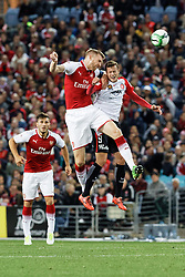 July 15, 2017 - Sydney, New South Wales, Australia - Arsenal player, Per Mertesacker and Wanderers player, Alexandre Lacazette race to head the ball first.FA Cup Champions Arsenal wins 3-1 over Western Sydney Wanderers FC at ANZ Stadium. (Credit Image: © United Images/Pacific Press via ZUMA Wire)