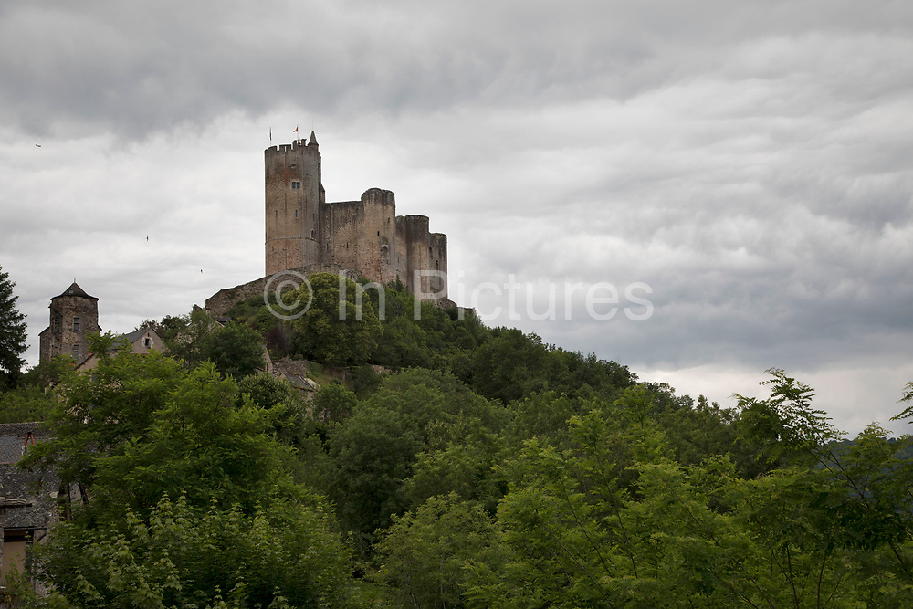Chateau de Najac in Najac, France. Chateau de Najac or the royal fortress of Najac is located in Najac, in the Aveyron departement, in southern France. The castle was built in 1253 by the villagers on the orders of Alphonse de Poitiers, brother of Saint Louis, on the site of an older castle a square tower built in 1100 by Bertrand of St Gilles, son of Raymond IV. The castle is built at the summit of a hill formed by a loop of the river. The castle has a world record with its 6.80 metre high archeres a thin aperture for archers, such a size being designed to allow use by three archers at the same time.