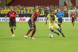 July 19, 2018 - Glendale, Arizona, U.S - Club America's ROGER MARTINEZ (9) attempts to pass Manchester United's ANTONIO VALENCIA (25) Thursday, July 19, 2018, at University of Phoenix Stadium in Glendale, Arizona. (Credit Image: © Jeff Brown via ZUMA Wire)