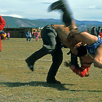 """MONGOLIA. Wrestlers at a """"Naadum"""" festival at Rinchenlhumbe in the Darhad Valley. This is one the the nation's most popular sports."""