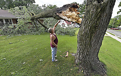 June 18, 2017 - Overland Park, Kansas, U.S. - MIKE APPLEBERRY looks over the break in the tree limb that fell on his home in the 5800 block of Lowell Street after an overnight storm brought high winds, lightning and rain. (Credit Image: © John Sleezer/TNS via ZUMA Wire)