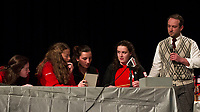 """Tate Aldrich looks on as the Sagacious Spellerzzz Cassie Sousa, Kaitlyn Brooks, Delia Cormier and Allyssa Miner work together to spell the word """"perspicacious"""" to win the final championship round of the Laconia High School Spelling Bee on Thursday evening.  (Karen Bobotas/for the Laconia Daily Sun)"""