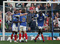 Photo: Lee Earle.<br /> Portsmouth v Manchester United. The Barclays Premiership. 07/04/2007.Portsmouth congratulate Matthew Taylor after he scored their second goal.
