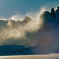 Wind-blown spindrift billows off the Filchner Mountains in Queen Maud Land.