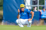 Rafa Cabrera Bello (ESP) surveys the line of his putt on the 14th green during the final round of the Aberdeen Standard Investments Scottish Open at The Renaissance Club, North Berwick, Scotland on 14 July 2019.