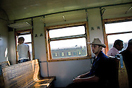 Passengers at the train  from  Yerevan to Gyumri ...Train goes two times a day and travels from 3.5 hours along Armenian -Turkish border. Rusted railway wagons are scattered around main stations like Hoktemberian.
