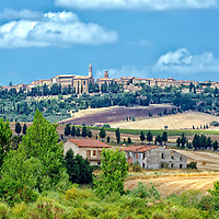 Pienza. Tuscany. Italy. Panoramic of the charming Renaissance and medieval hilltop town of Pienza in southern Tuscany. Set amid rolling dreamy and romantic Tuscan landscapes of the Val d'orcia, the pedestrian only town was transformed by Pope Pius II in the 15th century into a model for Renaissance town planning. It is a UNESCO World Heritage Site.