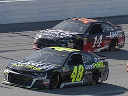 April 29, 2018 - Talladega, AL, U.S. - TALLADEGA, AL - APRIL 29: Jimmie Johnson, Hendrick Motorsports, Chevrolet Camaro Lowe's for Pros (48) and Clint Bowyer, Stewart-Haas Racing, Ford Haas Automation Demo Day (14) race through the trip-oval during the Monster Energy Cup Series 49th Annual Geico 500 on April 29, 2018, at Talladega Superspeedway in Talladega, AL. (Photo by Jeffrey Vest/Icon Sportswire) (Credit Image: © Jeffrey Vest/Icon SMI via ZUMA Press)