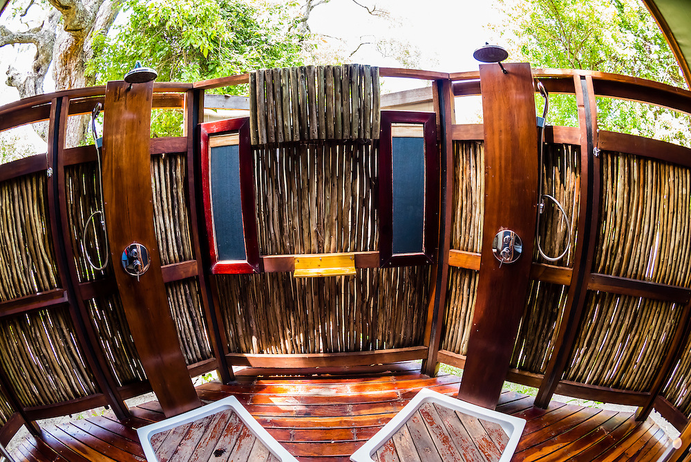Outdoor shower in a luxury tent, Lebala Camp, Kwando Concession, Linyanti Marshes, Botswana.