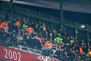 Despite a stadium ban, a contingent of Eintracht Frankfurt fans, supporters, present in the upper tier of the East Stand celebrate their side's second goal during the Europa League match between Arsenal and Eintracht Frankfurt at the Emirates Stadium, London, England on 28 November 2019.