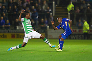 Liam Davis of Yeovil Town (L) tackles Lloyd Dyer (R) of Leicester City during the Skybet Championship match, Yeovil Town v Leicester City at Huish Park Stadium in Yeovil on Tuesday 1st October 2013. Picture by Sophie Elbourn, Andrew Orchard Sports Photography,