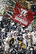 ATLANTA, GA - JANUARY 08:  Defensive back Tony Brown #2 of the Alabama Crimson Tide waves a flag after the College Football Playoff National Championship game against the Georgia Bulldogs at Mercedes-Benz Stadium on January 8, 2018 in Atlanta, Georgia.  (Photo by Mike Zarrilli/Getty Images)