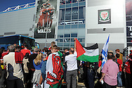 Wales fans watch as the team bus arrives outside the stadium before the match. Euro 2016 qualifying match, Wales v Israel at the Cardiff city stadium in Cardiff, South Wales on Sunday 6th Sept 2015.  pic by Andrew Orchard, Andrew Orchard sports photography.