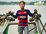27 OCTOBER 2015 - YANGON, MYANMAR: A ferry operator at Aungmingalar Jetty in Yangon. The jetty is one of the numerous crossing points that bring people from the suburbs on the other side of the river into Yangon.    PHOTO BY JACK KURTZ