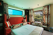 guest room of an house, double bed with pool window