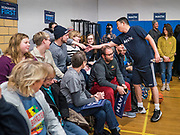 12 DECEMBER 2019 - DES MOINES, IOWA: ANDREW YANG shakes hands with spectators after a basketball game with J.D. Scholten in the gym in the Ames, IA, City Hall. Scholten is an Iowa Democrat running against Republican Congressman Steve King. Yang, an entrepreneur, is running for the Democratic nomination for the US Presidency in 2020. He brought bus tour to Ames, IA, Thursday. Iowa hosts the the first election event of the presidential election cycle. The Iowa Caucuses will be on Feb. 3, 2020.        PHOTO BY JACK KURTZ