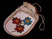 Plateau beaded deerskin bag with beaded floral designs.