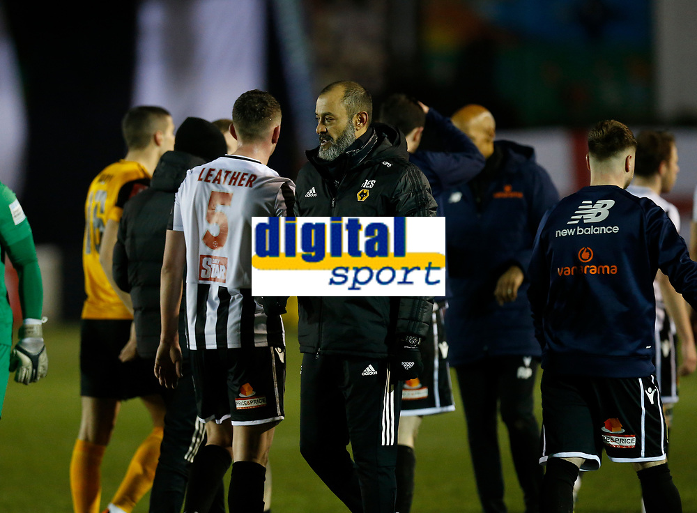 Football - 2020 / 2021 Emirates FA Cup - Round Four: Chorley vs. Wolverhampton Wanderers<br /> <br /> Wolverhampton Wanderers manager Nuno Espirito Santo congratulates Scott Leather of Chorley at the final whistle after his team earned a 1-0 victory, at Victory Park.<br /> <br /> COLORSPORT/ALAN MARTIN