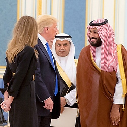 Saudi Prince Mohammed (or Mohammad) Bin Salman Bin Abdelaziz (or Abdul Aziz) Al Saud (right) meets with US President Donald Trump and First Lady Melania in Riyadh, Saudi Arabia on May 20, 2017. This is the first US president's visit abroad. Photo by Balkis Press/ABACAPRESS.COM