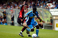 Photo: Alan Crowhurst.<br />Wycombe Wanderers v Lincoln City. Coca Cola League 2. 23/09/2006. Anthony Grant of Wycombe (R) attacks the defence.
