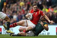 George North of Wales is tackled by Tendai Mtawarira of South Africa whilst attempting to score a try. Rugby World Cup 2015 quarter final match, South Africa v Wales at Twickenham Stadium in London, England  on Saturday 17th October 2015.<br /> pic by  John Patrick Fletcher, Andrew Orchard sports photography.