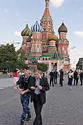 Moscow, Russia, 14/06/2006.&#xA;Plain  clothes Kremlin guards detain a uniformed Russian Interior Ministry officer armed with an automatic rifle and handgun. The officer had been accompanying a group of foreign businessmen on Red Square as private security.<br />
