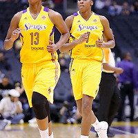 25 May 2014: Los Angeles Sparks forward/center Sandrine Gruda (7) goes back to the bench behind Los Angeles Sparks forward Farhiya Abdi (13) during the Los Angeles Sparks 83-62 victory over the San Antonio Stars, at the Staples Center, Los Angeles, California, USA.
