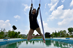 July 16, 2018 - Ganzhou, Ganzhou, China - Ganzhou, CHINA-A woman practices anti-gravity in Ganzhou, east China's Jiangxi Province. (Credit Image: © SIPA Asia via ZUMA Wire)