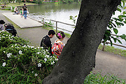 just married bride and groom sitting by them self in a public park